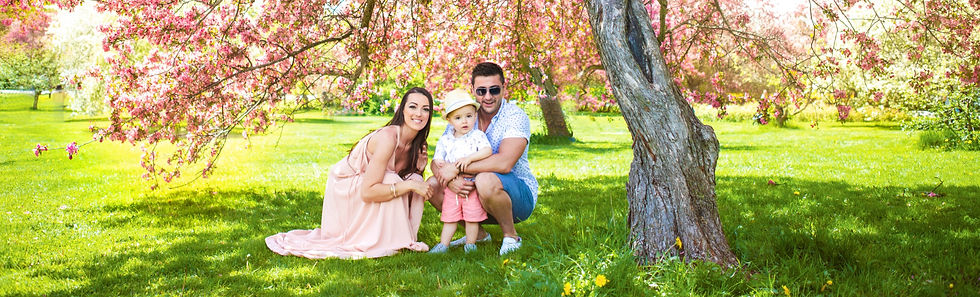 Family photo under cherry blossoms
