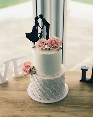 2 tier 8+6inch, hand piped +sugar roses $420