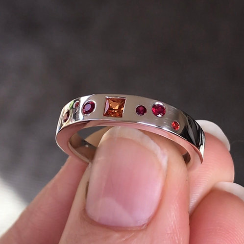 Orange sapphire and ruby ring