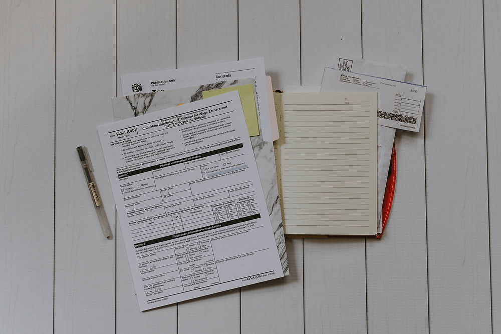 legal paperwork, forms, and pen on desk