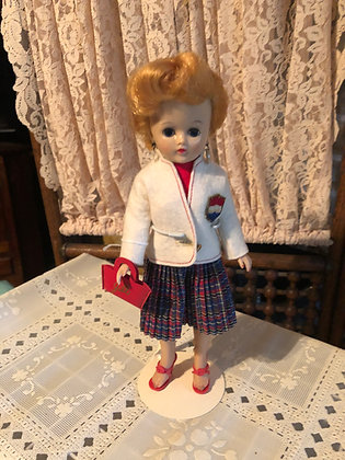 Jill Doll, 1958 in pleated skirt and white blazer outfit