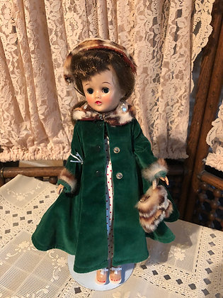 Jill Doll, 1957 in dress and green velvet coat ensemble