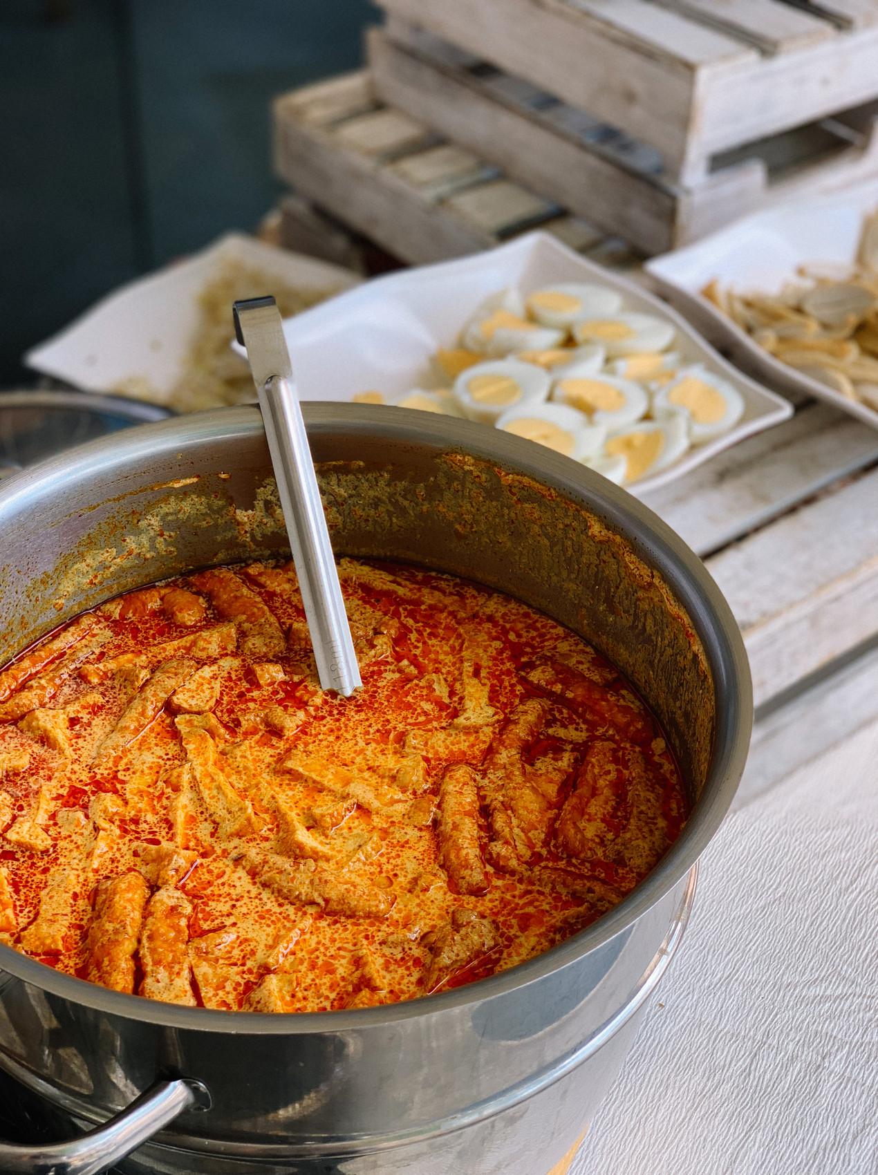 Nyonya laksa live station by manna pot catering