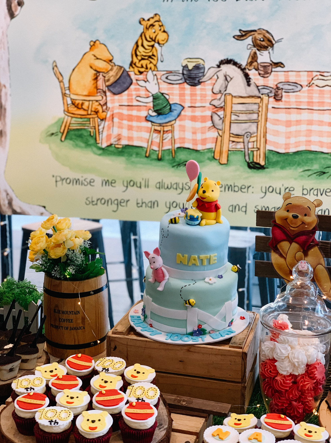 customised Winnie the pooh dessert table with 2-tier fondant birthday cake