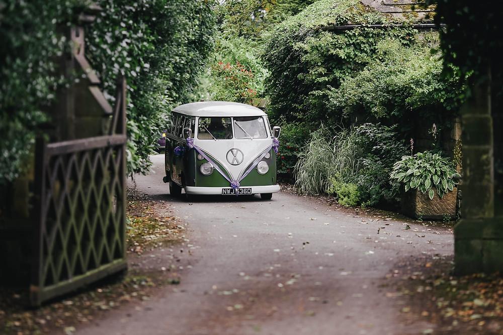 Photo of an old model green Volkswagen van