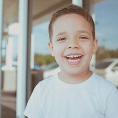 smiling%2520boy%2520wearing%2520white%25