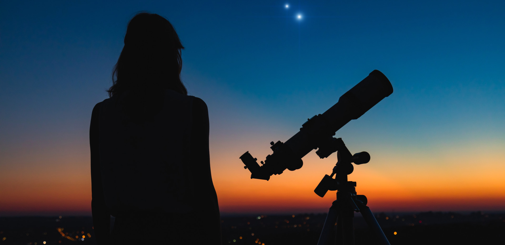 Woman looking at night sky with amateur
