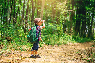 Children go hiking at backyard with back