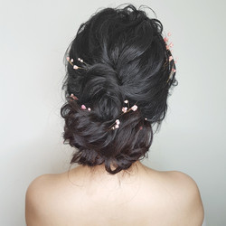 Loose romantic wavy up do