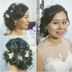 Messy side bun with braids for Serene today _malena_bridal ! Baby breath and pink flowers to complet