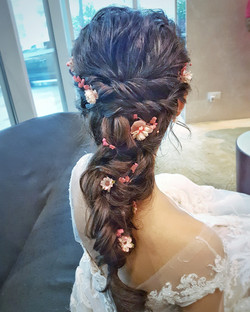 Romantic long braid with flowers