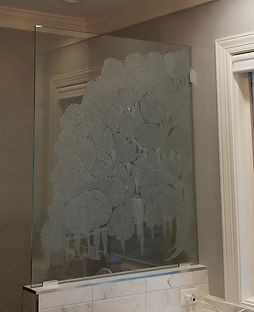 Peggy's Oak Custom, Hand-Engraved glass partition.