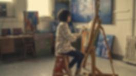 woman-sitting-on-brown-stool-374054.jpg