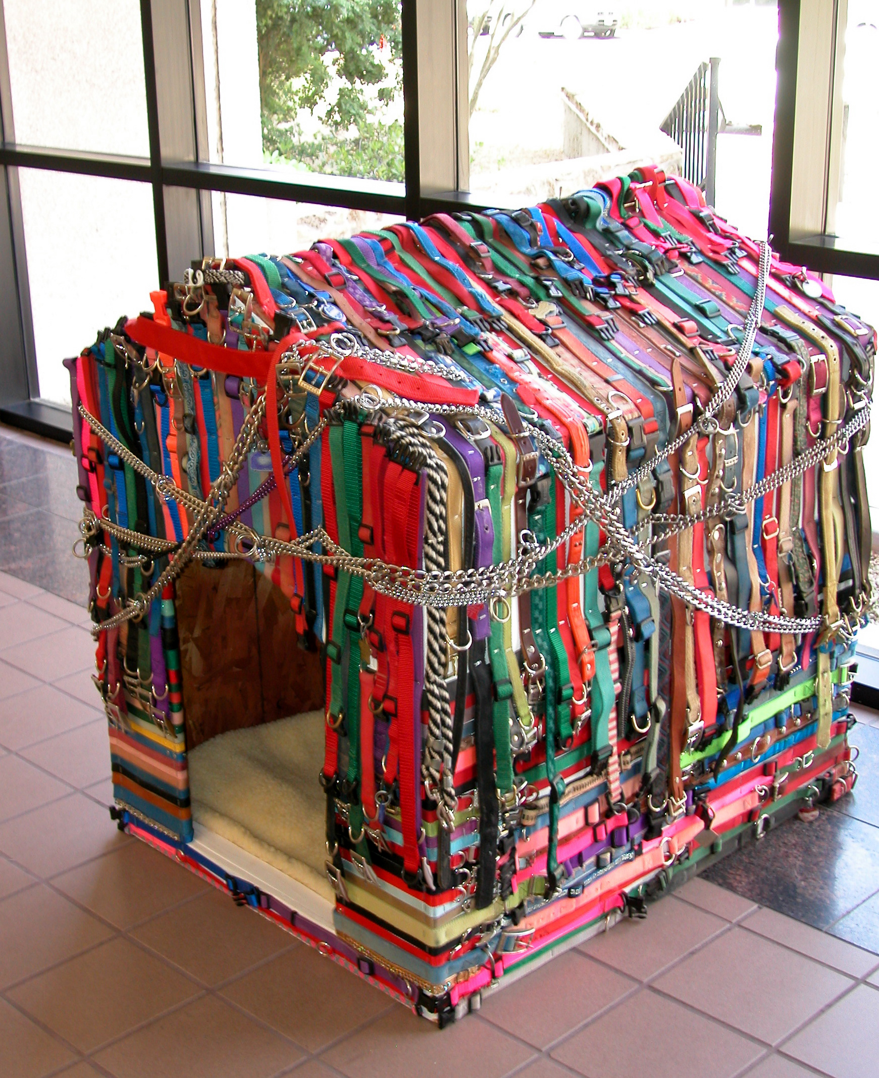 Carry Me Home, wood with 575 dog collars from shelters