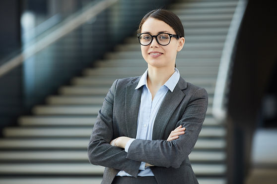 positive-young-female-intern-in-glasses-