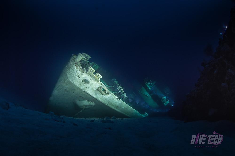 Light painting shot of the USS Kittiwake bow at night.