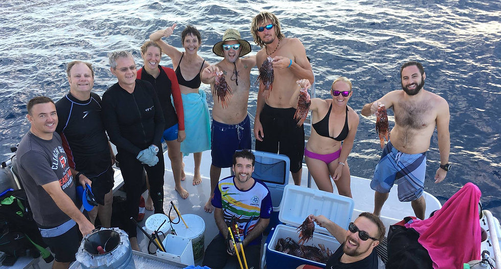 Grand Cayman lionfish hunters show off their catch on the deck of Divetech's dive boat, Atatude.