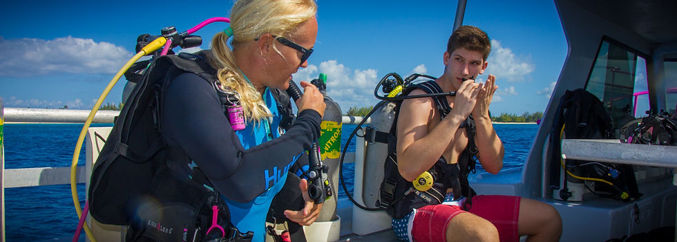 A divetech instructor briefing a discoer scuba student