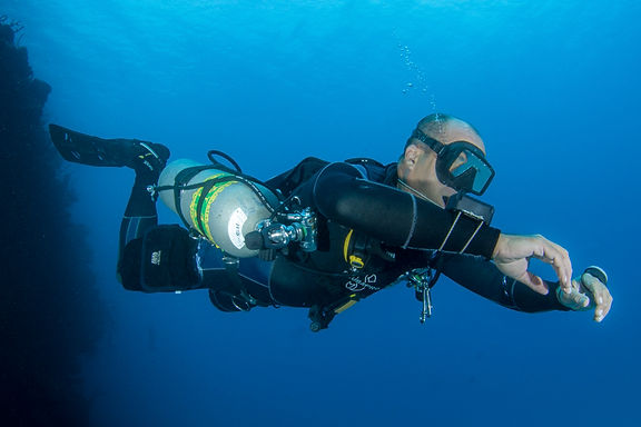 A sidemount diver in Grand Cayman