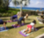 Yoga on the side lawn of Lighthouse Point Dive Resort in Grand Cayman.