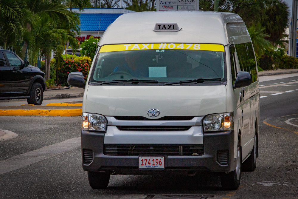 A Cayman Islands taxi van.