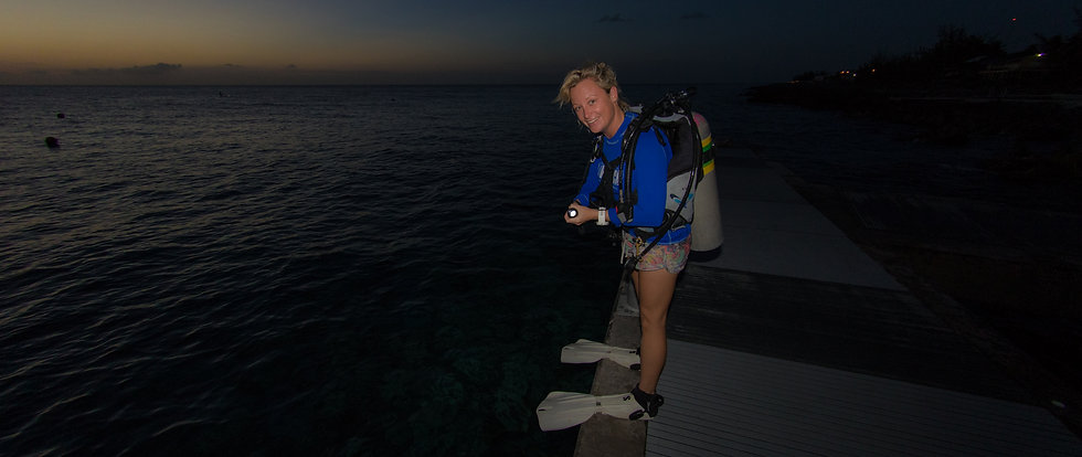 Divetech instructor preparing for a night dive in Grand Cayman
