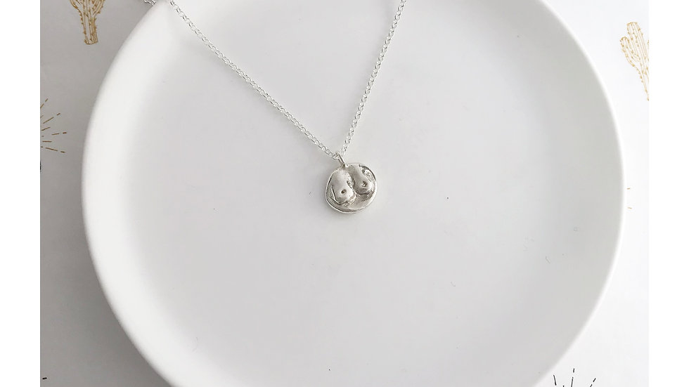 BOOBS PENDANT SILVER