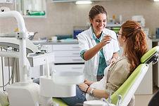 Female dentist in dental office talking