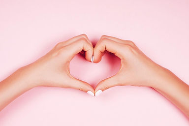 woman-making-heart-sign-with-her-hands-o