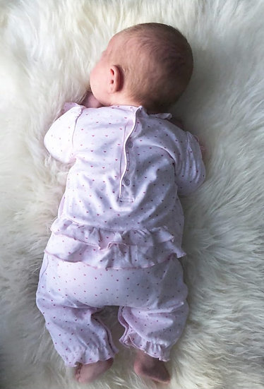 Kissy Kissy footless pink babygrow with pink hearts