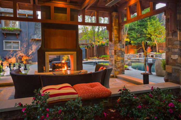 backyard-patio-with-wood-and-stone-pavil