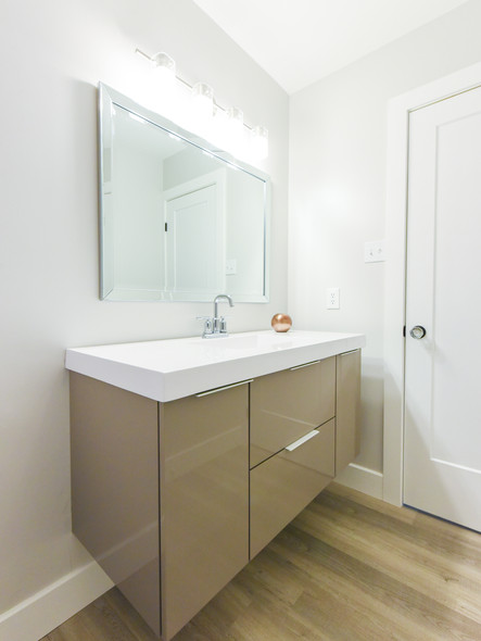 Floating vanity with high gloss acrylic panels.