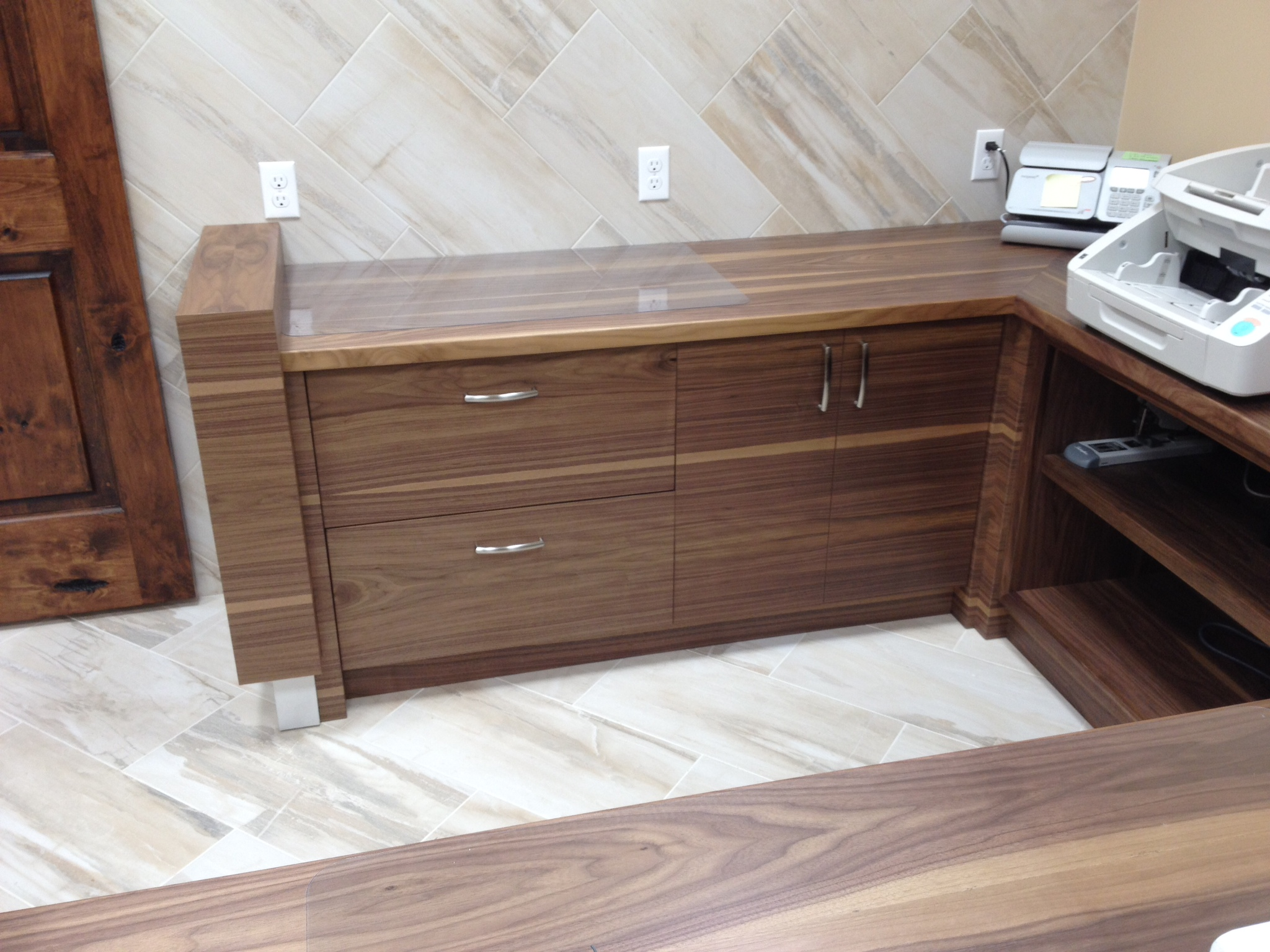 Walnut grain matched reception desk.