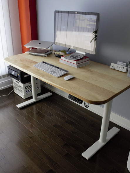 Sit & stand desk with birch top.