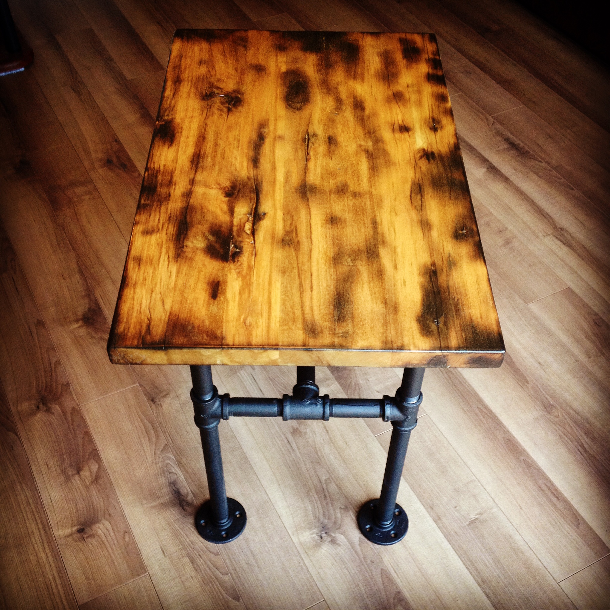 Rustic Burned Wood Pipe Leg Table
