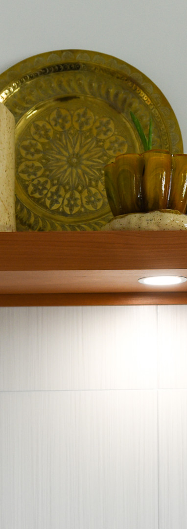 Floating solid cherry shelf with lightin