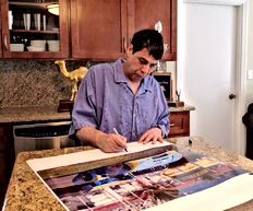John+autographing+posters.jpg