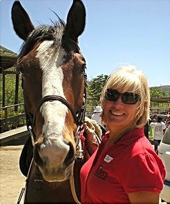 Bobbi, Assistant Director with retired therapy horse, Sly