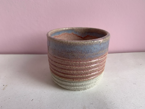 Pink and blue ribbed coffee cup