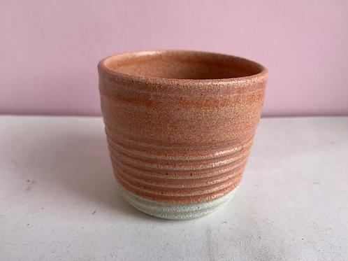 Orange ribbed coffee cup