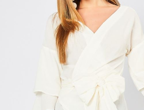 V-neck wrap top featuring tiered bell sleeves