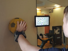Ball-on-wall shoulder activity. Roll the ball in a circle movement while pressing towards the wall
