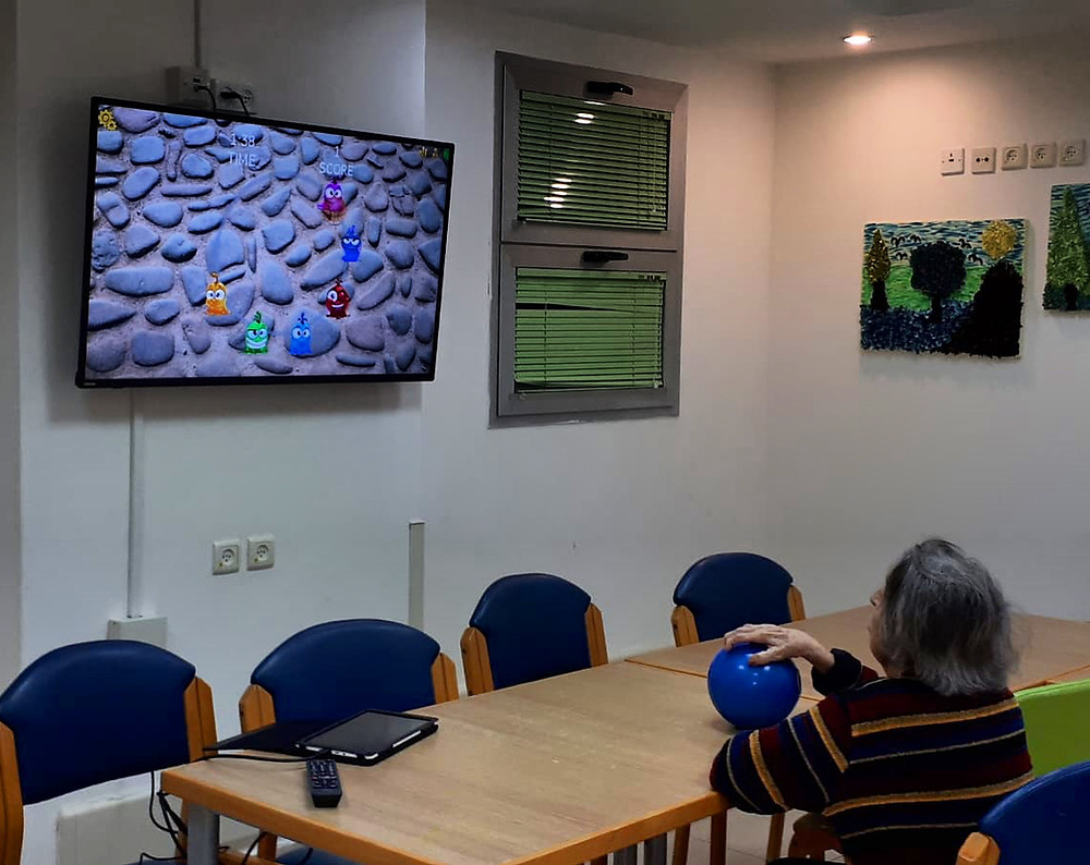 Description: Care for our senior population during social distancing. Resident is regaining upper limb function after stroke using PlayBall interactive ball exercises and games.