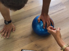 Apply force on the ball from different angles in push-up position