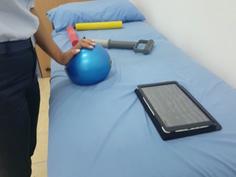 Patient after distal radius fracture doing her wrist press activity