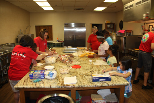 The A.C.T.S.4Kids crew in the kitchen!