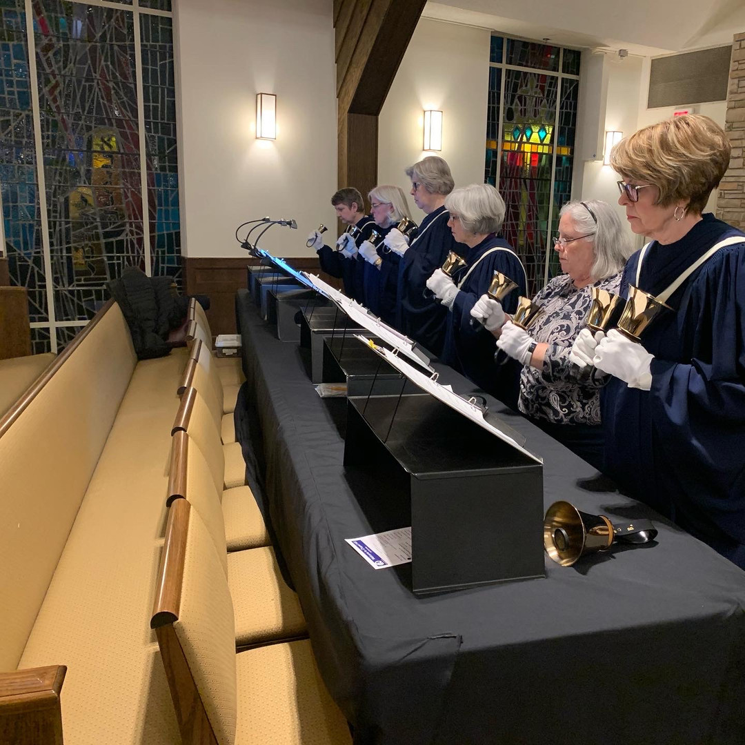 Bell players practice before the service.