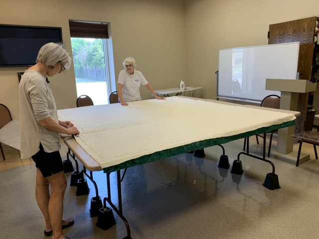 More creative types ... at work in Fellowship Hall because they don't have a big enough space at home.