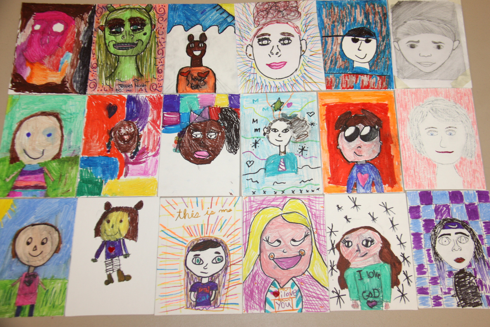 Drew self portraits at ACTS4Kids this month.