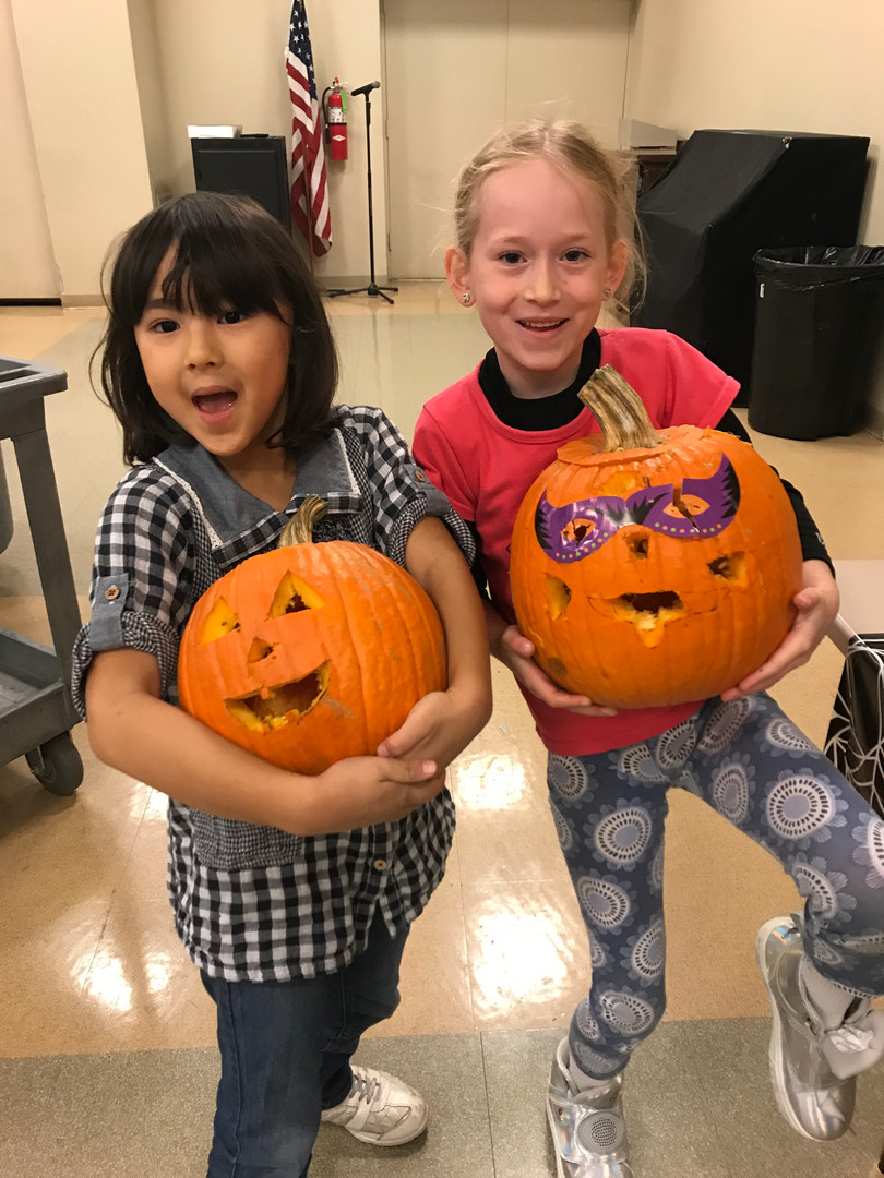 Do they look excited to take their pumpkins home?